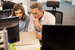 High angle view of business colleagues working together in office Royalty Free Stock Photos