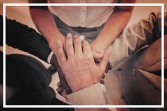 Business people gathering their hands together Stock Photo