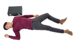 High angle view of businessman sleeping by briefcase Royalty Free Stock Photography