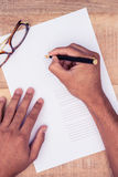 High angle view of businessman writing on paper Stock Photography
