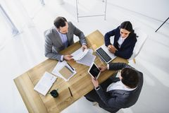 High angle view of businesspeople working with digital devices. In office royalty free stock image