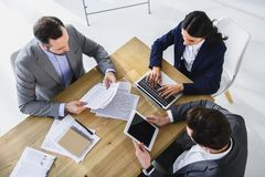 High angle view of businesspeople working with gadgets. In office royalty free stock photo
