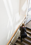 High angle view of businesswoman ascending stairs Stock Photography