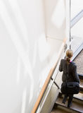 High angle view of businesswoman ascending stairs Stock Images