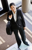 High angle view of businesswoman holding briefcase Stock Photo