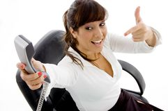 High angle view of businesswoman pointing at phone Stock Photo