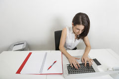 High angle view of businesswoman using laptop at desk in office Royalty Free Stock Photos