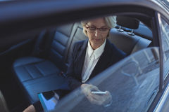 High angle view of businesswoman using phone in car Stock Photography