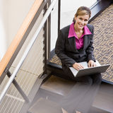 High angle view of businesswoman working on laptop Stock Images
