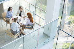 High angle view of businesswomen discussing at table in office Royalty Free Stock Photography
