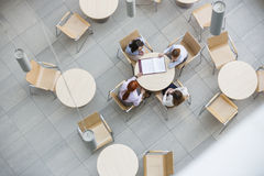High angle view of businesswomen doing paperwork in office canteen Royalty Free Stock Image