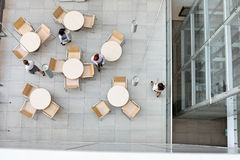 High angle view of businesswomen walking at office canteen Royalty Free Stock Photos