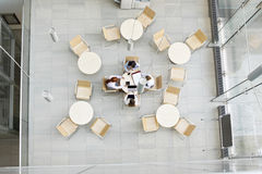 High angle view of businesswomen working in office canteen Royalty Free Stock Images