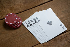 High angle view of cards and maroon chips Royalty Free Stock Photography