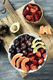Fruit salad in a ceramic bowl Royalty Free Stock Photo