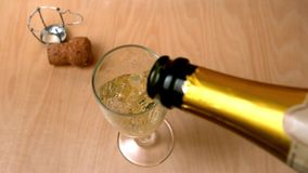 High angle view of champagne being poured into flute Stock Images