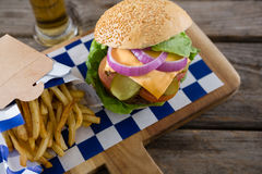 High angle view cheeseburger served with french fries and beer Royalty Free Stock Photos