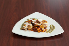 High angle view of chicken dish with salsa Stock Images