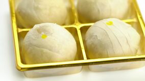 High angle view of chinese pastry or bean cake filled with sweet pasted mung bean and salted egg yolk.