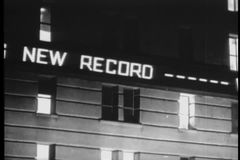 High angle view of city street and electronic news ticker at night stock video