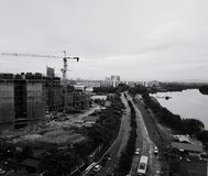 High angle view of cityscape with construction site, road and ri Royalty Free Stock Photo