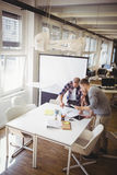 High angle view of colleagues discussing in meeting room Royalty Free Stock Image