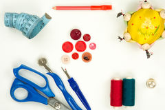 High angle view of a collection of sewing items. Isolated on white background stock photos