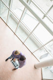 High angle view of college students using laptop Royalty Free Stock Images