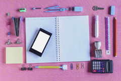 High Angle View of Colorful School Supplies Organized by Type Around Note Book Royalty Free Stock Image