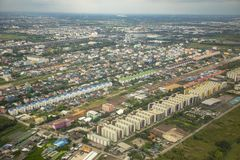 High angle view of condominium building and home village over outskirt of bangkok thailand capital royalty free stock photos