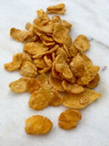 High angle view of cornflakes on a white marble plate. In closeup Stock Photography
