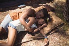 High angle view of couple sleeping on field Stock Photos
