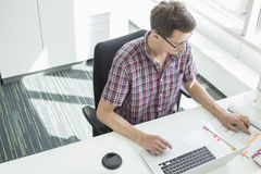 High angle view of creative businessman working at desk in office Stock Photography