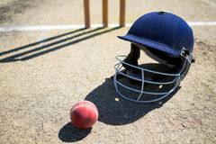 High angle view of cricket ball with helmet on pitch Royalty Free Stock Images