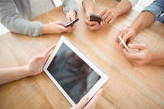High angle view of cropped hands using smartphones and digital tablet Stock Image