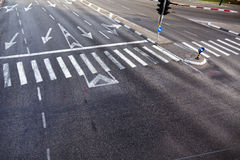 Intersection Zebra Crossing. High angle view of a crosswalk on a 4 lane  & 2 lane city street Stock Photo
