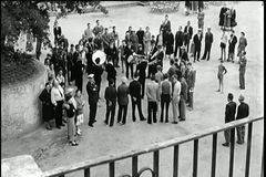 High angle view of crowd gathering in street to listen to band stock footage