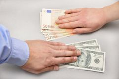 High angle view of currency exchange. Close up a money changing hands of people at bank royalty free stock photography