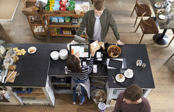 High angle view of customer at the counter of a coffee shop Royalty Free Stock Photo