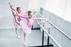 high angle view of cute little ballet dancers stretching royalty free stock photo