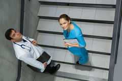 High angle view of doctor and surgeon standing together on staircase Stock Photography