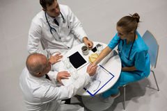 High angle view of doctors and surgeon shaking hands Stock Photography