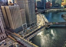 High angle view of el train passing over glittering waters of Chicago River in March morning in winter. royalty free stock photo