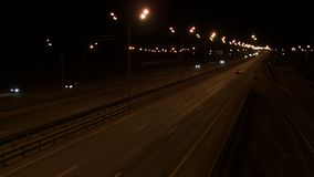 High angle view of an evening city road. Trucks and cars passing by stock footage