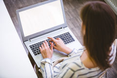 High angle view of executive typing on laptop at office Royalty Free Stock Photography