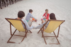 High angle view of family enjoying at beach Royalty Free Stock Photo
