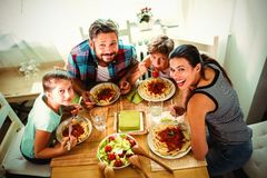 High angle view of family having meal together. At home royalty free stock images