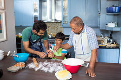 High angle view of family preparing food. While standing in kitchen at home Stock Images