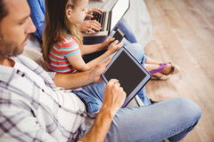 High angle view of family using technologies Royalty Free Stock Images