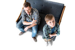High angle view of father and son quarreling Stock Image